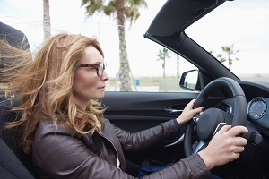 Image of Woman driving with hearing aids.